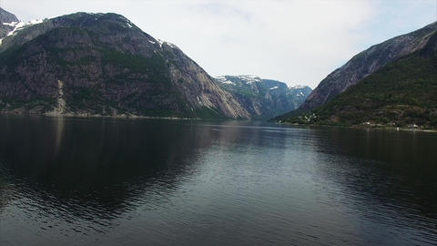 Flying above the dark waters of famous Hardanger fjord in Norway Footage
