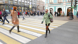 Young woman quickly go across city road POV shot, walk on pedestrian crossing Footage