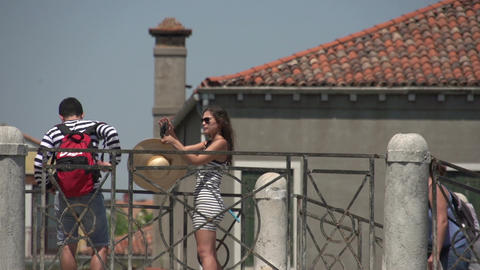 Woman takes selfie picture on bridge in Murano Footage