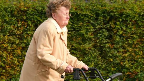 pensioner wheel walker in autumn park side close 11771 Live Action