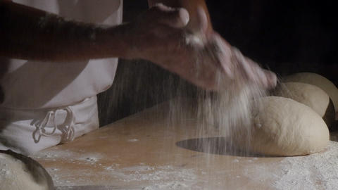 baker clapping with flour powder in hands spotlight 4k 11773 Footage