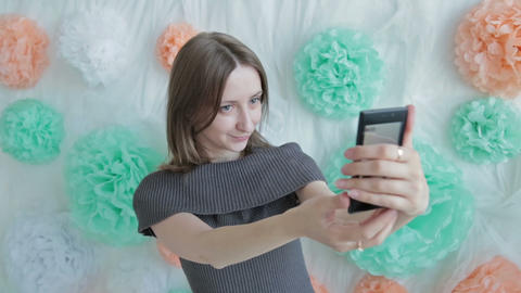 Young pretty woman taking selfie at photographic studio Footage