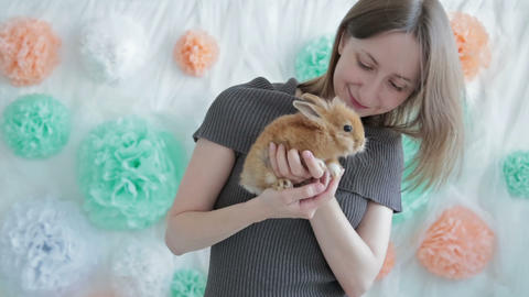 Woman Holding Little Cute Rabbit stock footage