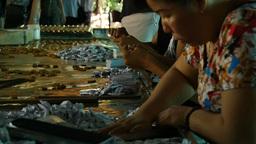 MEKONG DELTA, VIETNAM - 2015: Vietnamese Factory workers working with hands Footage