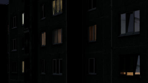 4K Time Lapse of Windows of Multistory Apartment House After Sunset Footage
