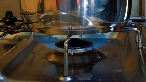 Cooking On A Gas Stove stock footage