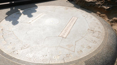 Metallic outline symbols, sculpture on stone pavement, compass and azimuth ビデオ