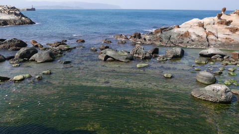 Calm sea water over rocky shore at north side of Yehliu Geopark cape Footage