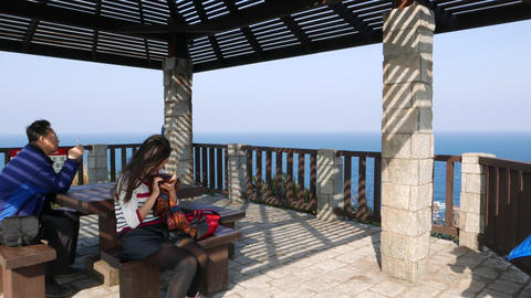 Tourists look at smartphones ignore breathtaking panorama at Yehliu cape edge Footage