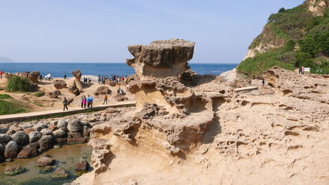 Odd eroded stone formation against mushroom rocks field, parallax shot Footage