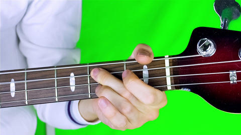 Man playing guitar on a green screen Footage