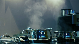 Steam From The Pots On The Stove. Seamless Loop stock footage