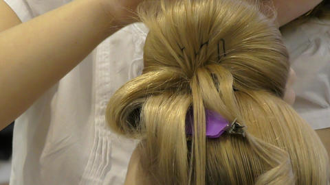 Hairdresser makes woman hairstyle Footage