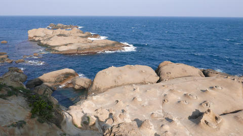 End of Yehliu Geopark cape, sea rocks in water Footage