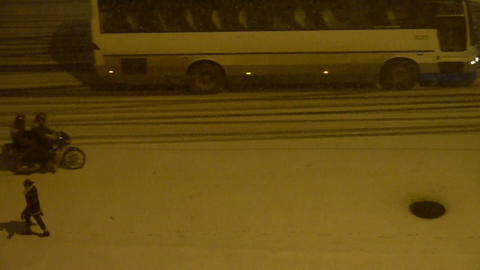 Vehicle car traveling on road in snow at night,traffic,motorcycle Footage