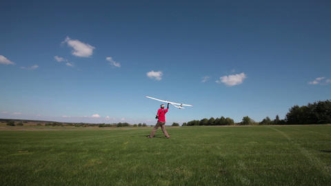 Man launches into the sky RC glider Stock Video Footage
