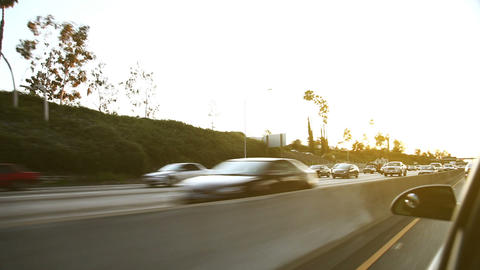 Oncoming traffic on american highway at sunset Stock Video Footage