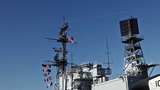 USA flag and antennas on carrier control tower in blue sky Footage