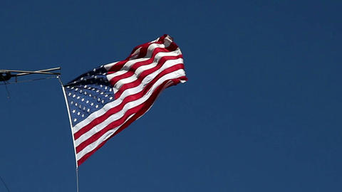 USA flag flying on the wind on blue sky background Stock Video Footage