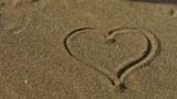 heart on golden sandy beach,wind blow sand Footage