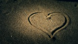 heart on sandy beach,wind blow sand Footage