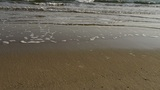 waves on sandy beach,bubble and blister on sand Footage