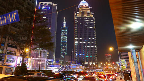 Taipei 101 skyscraper illuminated in night, long slide shot 影片素材