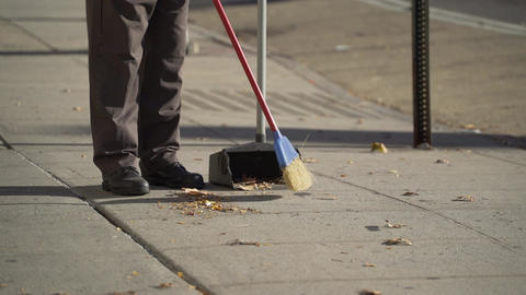 Sweeping the sidewalk Live Action