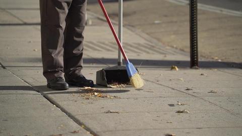 Sweeping the sidewalk Footage