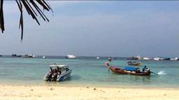 Boat Sailing Near The Beach stock footage