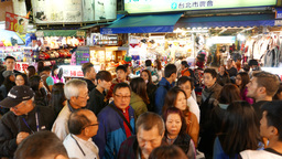 Huge crowd at street crossing, near Shilin market, night time, overhead view Footage