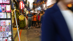Young visitors of night garments shopping street, Shilin area, taiwanese faces Footage