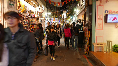 Stylish casual garments shopping street, market-like, night time Footage