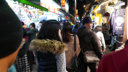 Entering and following people flow, nightlife at crowded street bazaar Footage