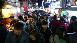 Overcrowded intersection, street filled up by many people, slowly walking Footage