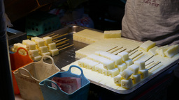 Tray with white sponge sugar cake, sticking on a stick, close up Footage