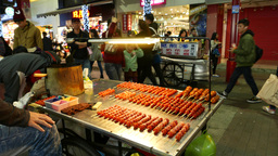 Fresh short chinese sausages booth at night street, cooking selling Footage