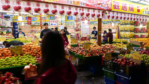 Modern and bright fruit shop, view from night street, stalls with products heaps Footage