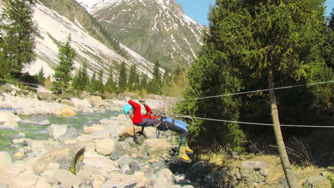 A Man Crossing The Mountain River By A Rope Crossing Footage