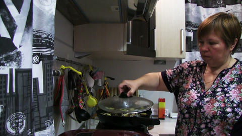 Woman Preparing Food In The Pan Live Action