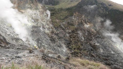 Fumaroles at deadly mountain slope, white fume rise from solfatara Live Action