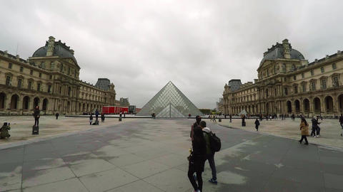 Louvre. The famous art museum in Paris. Pyramid. France. 4K Live Action