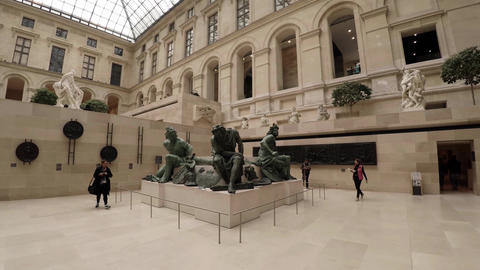 Statues and sculptures in the Louvre museum in Paris. France. 4K Footage