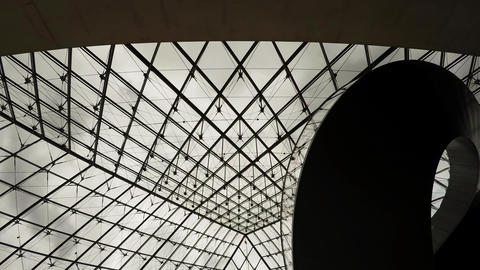 The ceiling glass pyramid at the Louvre museum in Paris. France. 4K Footage