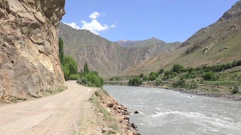 River Flowing Through Mountains, Pamir Mountains, Tajikistan Footage