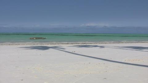 Boat On Beach Against Blue Sky Footage