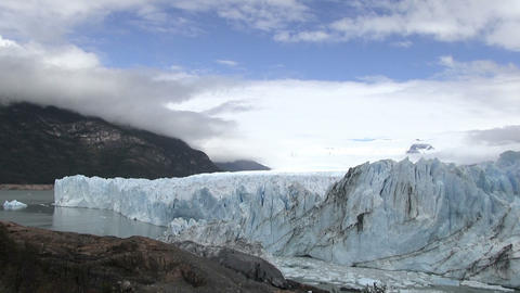 Perito Moreno Glacier in a Lake Against Cloudy Sky Footage