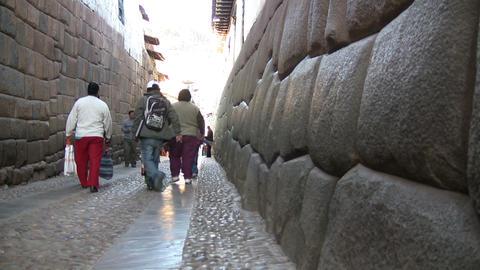 People walking in alley Footage