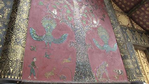 Artwork on the wall Wat Xieng Thong, Luang Prabang, Laos Footage