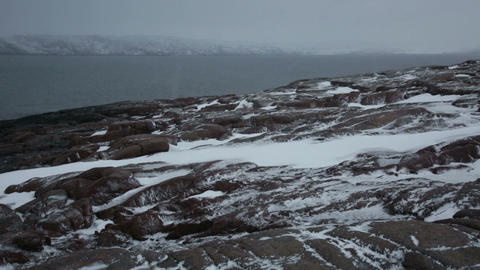 Snow Storm On The Rocky Shores Of The Arctic Ocean stock footage